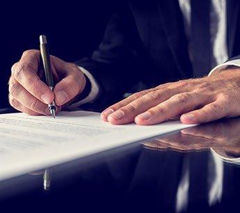 Kelowna mortgage broker - John Antle - signing documents