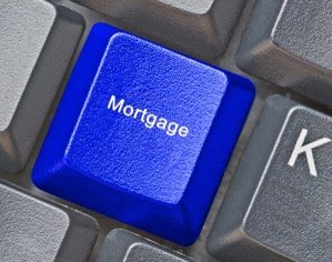 Kelowna mortgage broker - John Antle - keyboard with mortgage button